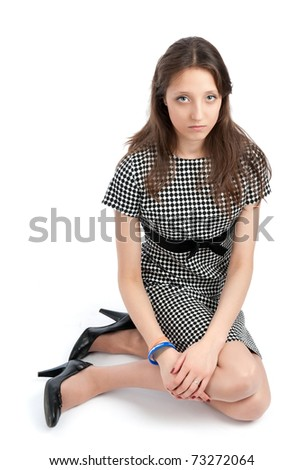 attractive young woman sitting on a floor. isolated on white - stock photo