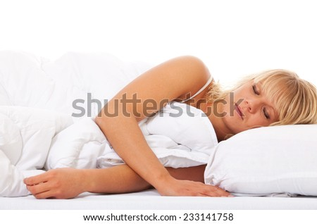 Attractive young woman sleeping in bed. All on white background. - stock photo