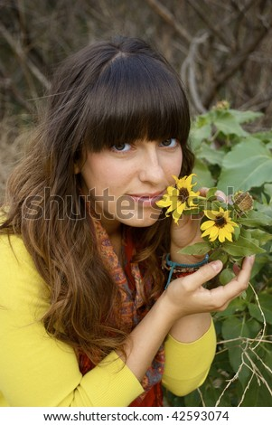 Attractive Young Woman smelling the flowers