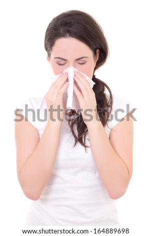 ... young woman sneezing isolated on white background - stock photo
