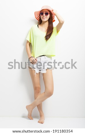 attractive young woman standing on a white background - stock photo