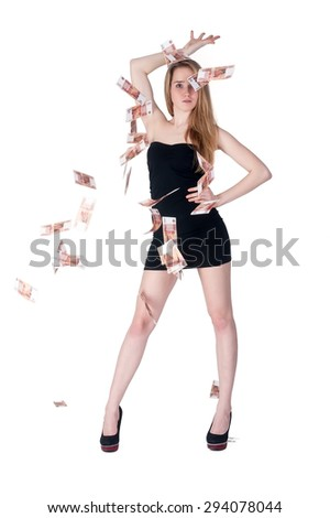 Attractive young woman stands among flying russian currency - roubles - stock photo