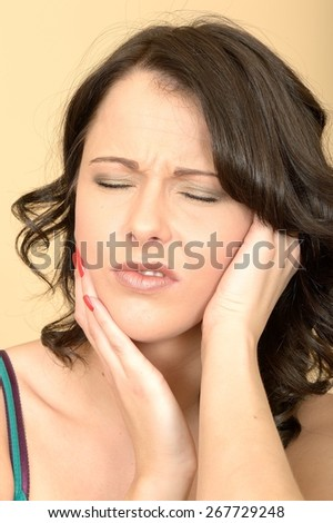 Attractive Young Woman Suffering With a Painful Toothache - stock photo