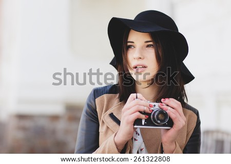 Attractive young woman talking pictures outdoor - stock photo