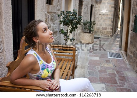 Attractive young woman travels through the streets of Montenegro - stock photo