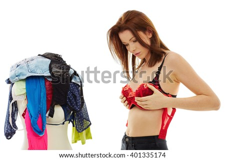 Attractive Young woman trying her bra, isolated over white background - stock photo