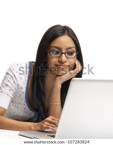 Attractive young woman using internet on laptop computer.  Isolated against white background. - stock photo