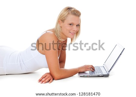Attractive young woman using laptop. All on white background.