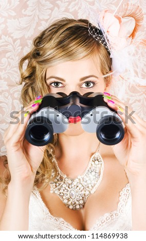 Attractive Young Woman Watching Spring Carnival Horse Races Through Binoculars In A Depiction Of Race Day Fashion - stock photo