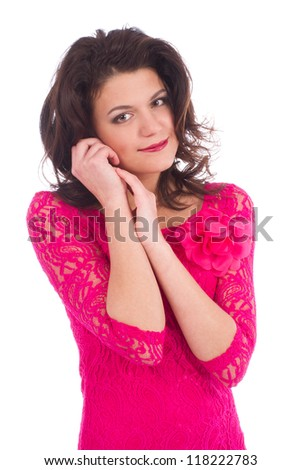 Attractive young woman wearing a pink dress isolated over white background
