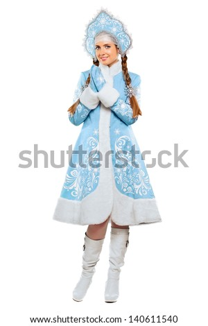 Attractive young woman wearing blue suit of snow maiden. Isolated on white  - stock photo