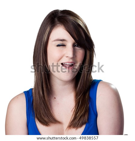 Attractive young woman winks at the viewer - stock photo