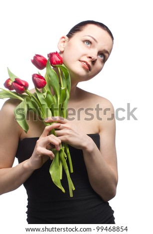 Attractive young woman with a red tulips on white background