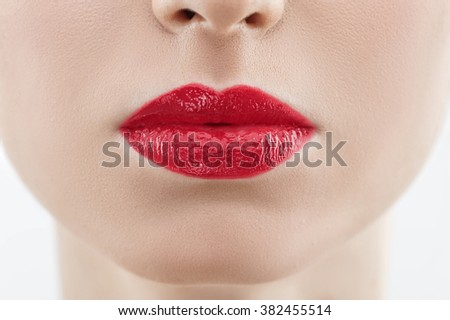 Attractive young woman with a seductive mouth - stock photo
