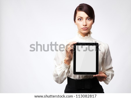 Attractive young woman with a tablet pc, white background