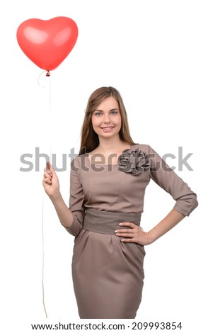 Attractive young woman with balloon in the form of heart isolated on white
