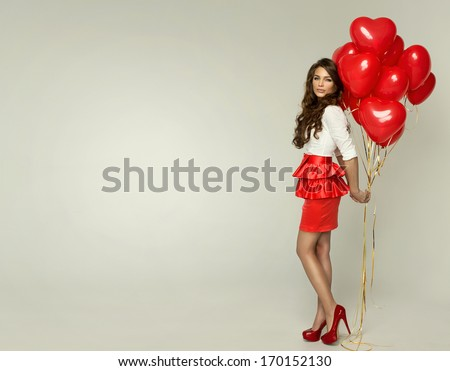 Attractive young woman with balloon on Valentine Day  - stock photo