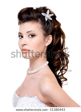 Attractive young woman with beautiful wedding hairstyle - isolated on white