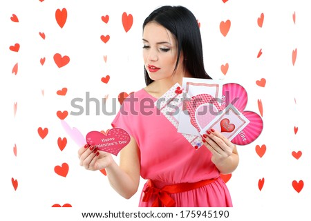 Attractive young woman with cards on Valentine Day - stock photo