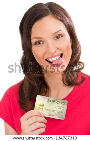 Attractive young woman with credit card showing tongue - stock photo
