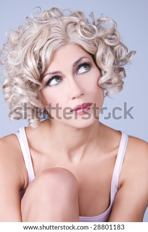 Attractive young woman with curly hair - stock photo