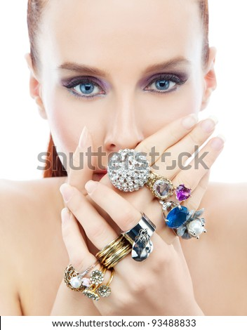Attractive young woman with diamonds on the hands looking to the camera on the white background - stock photo