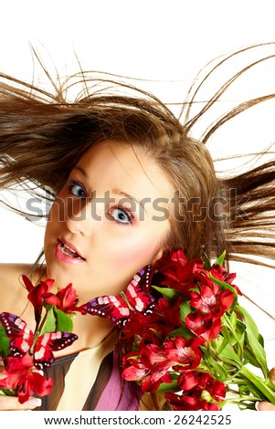 Attractive young woman with flowers, wind in hair