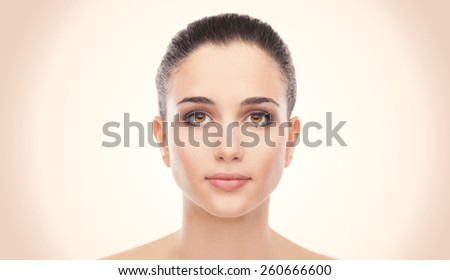 Attractive young woman with glowing face skin  - stock photo