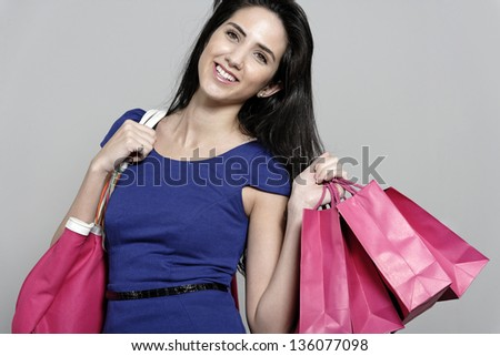 Attractive young woman with lots of shopping bag from a day out shopping.
