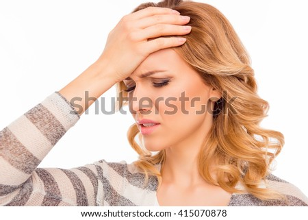 Attractive young woman with migraine touching her head - stock photo