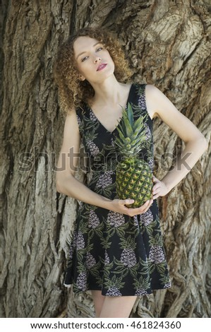 Attractive young woman with pineapple