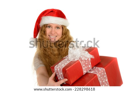 attractive young woman with rad hair in santa hat with christmas - stock photo