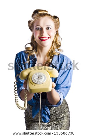 Attractive young woman with retro telephone, white studio background - stock photo
