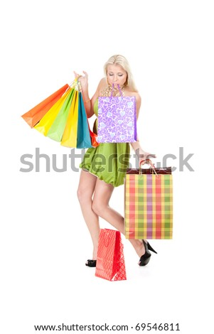 attractive young woman with shopping bags in her hands and teeth losing one
