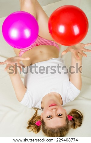 Attractive young woman with two ball - stock photo