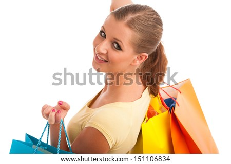 attractive young woman with vibrant shopping bags isolated over white background