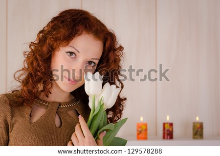 Attractive young woman with white tulips - stock photo