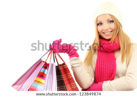 Attractive young woman woman with lot of shopping bags, isolated on white - stock photo
