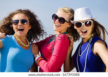 Attractive young women having fun outdoors. Summer vacation - stock photo
