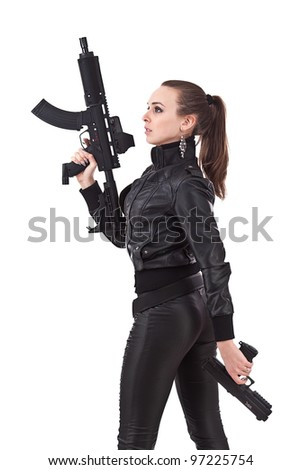 Attractive young women holding weapons. - stock photo