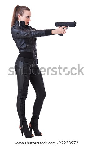 Attractive young women holding weapons, isolated on white background. - stock photo
