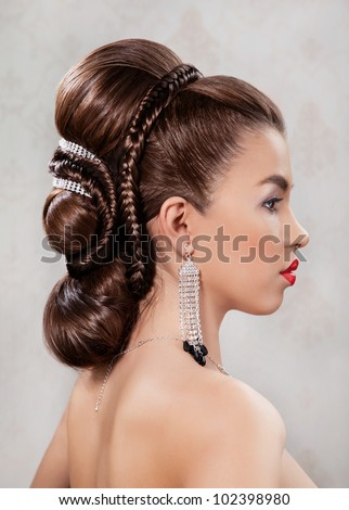 Attractive young women with evening hair decorating with a jewelry and plait - stock photo