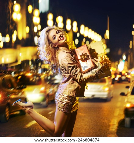 Attractve blonde beauty with a gift - stock photo
