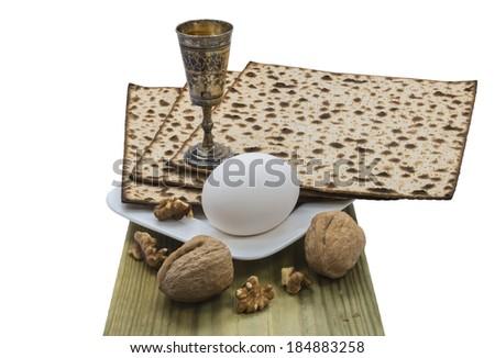 Attributes of Jewish Passover Seder celebration isolated on white background - stock photo