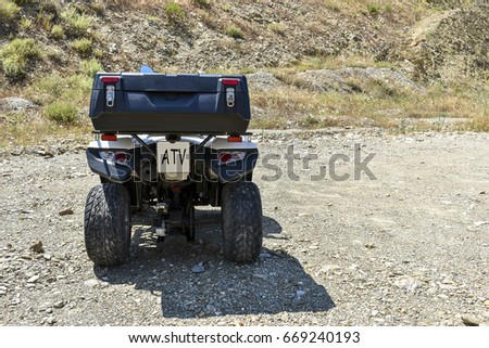 ATV offroad on mountain and sky background. Greece