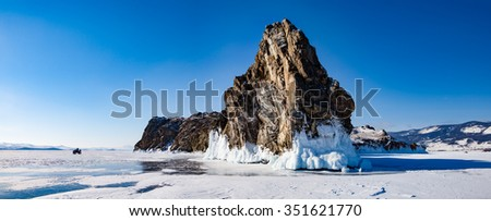 ATV on the ice of Lake Baikal - stock photo