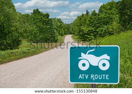 ATV Route :  A road sign identifies a route for all-terrain vehicles in central Wisconsin.  - stock photo