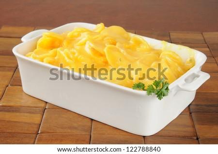 Au gratin potatoes in a casserole dish - stock photo