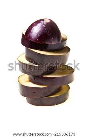Aubergine(eggplant) slices on a white background.