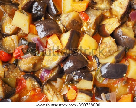 Aubergine (Solanum melongena) aka egg plant or melongene or garden egg vegetables with Tomato and carrots, vegetarian food - stock photo